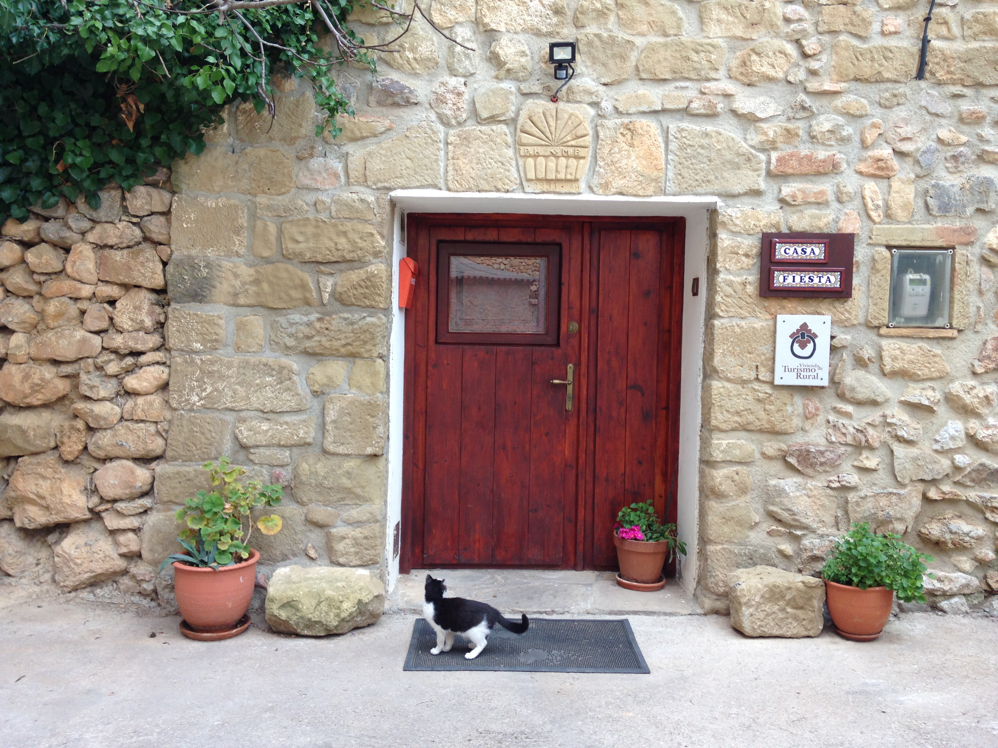 Banner image; view of the house with Turismo Rural plaque and Sam the cat